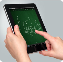 User tapping DigitalPlaybook app on an iPad for Sports Team